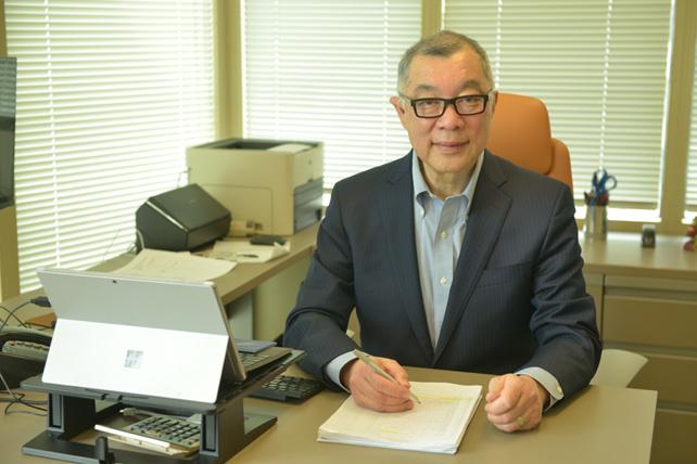 Jeffrey Lowe at desk